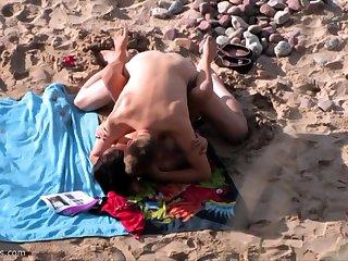 British untrained MILF sucks cock on Greek beach