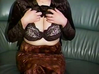 Horn-mad a bit chesty amateur cam MILF plays with her huge knockers