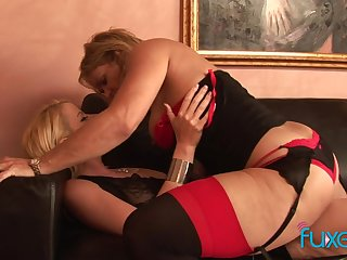 Sated temptress be incumbent on a MILF fucks a pretty young woman with a strap-on