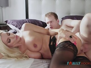 Sizzling blnde COUGAR is wearing softcore, dark-hued stocking while having fuck-a-thon with her spouse's mate