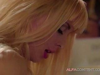 A blonde nurse with big tits takes a break
